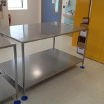 Fixed height stainless steel tables