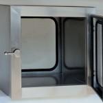 Double door interlocked pass through hatch