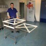 Extending tray for health and safety when loading endoscope trays