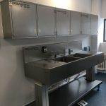 Height adjustable sink with wall cupboards