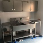 Single wash sink, chemical dosing, wall cupboards and side tables