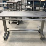 Height adjuastable table with wrapping bars