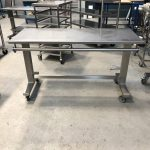 Height adjustable table with wrapping bars