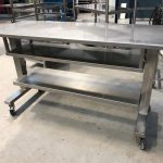 Triple height adjustable packing table