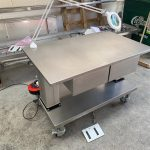 Electrically height adjustable packing table with drawers